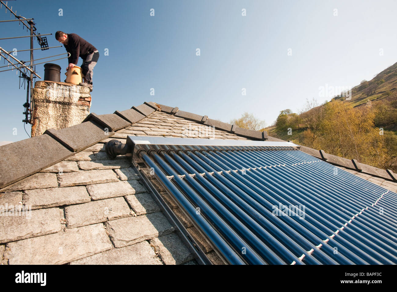 A solar panel water heater on a house roof in Ambleside Cumbria UK ...