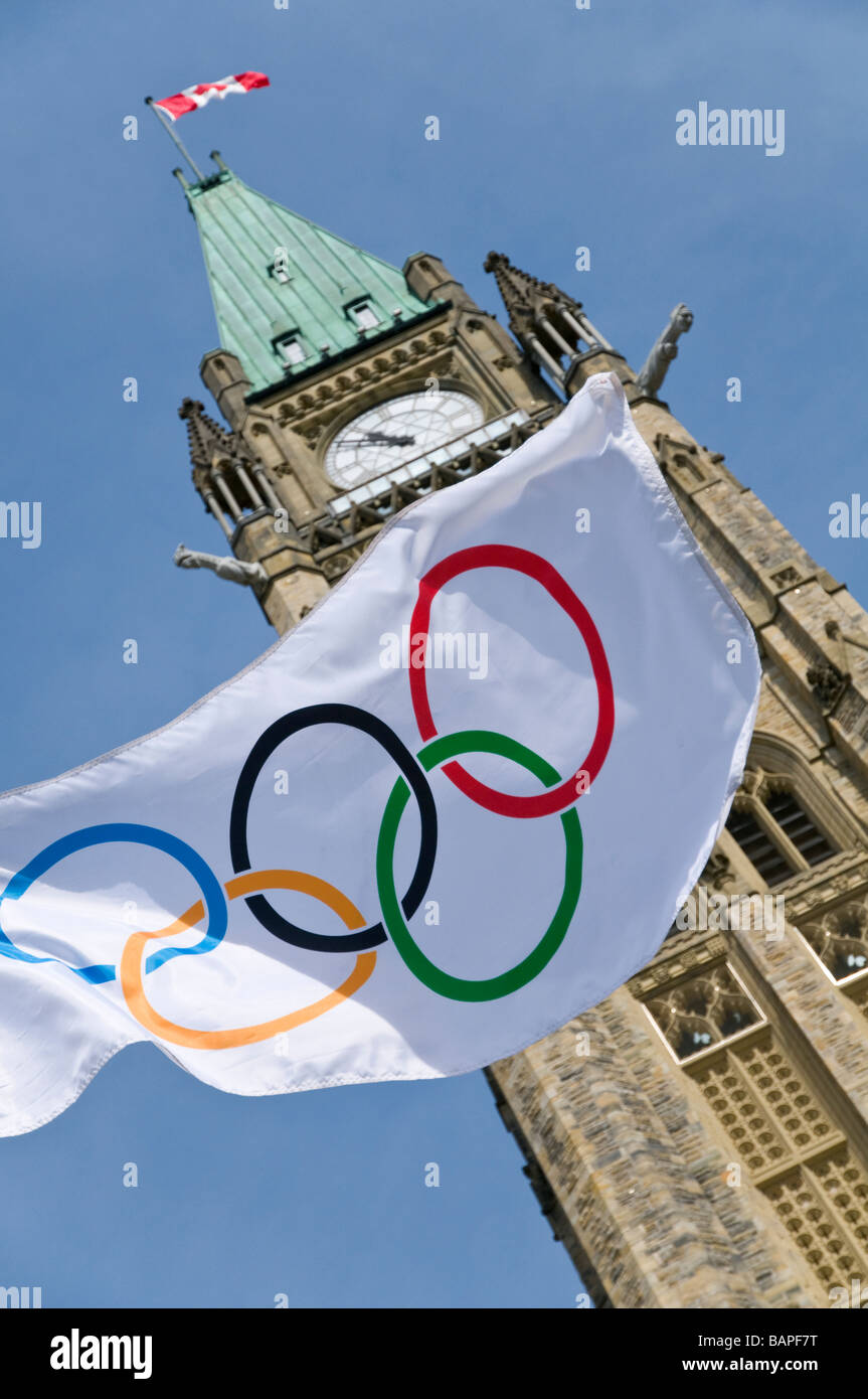 The Olympic flag flying in front of the Peace Tower at the Canadian Parliament Buildings in Ottawa. - Stock Image