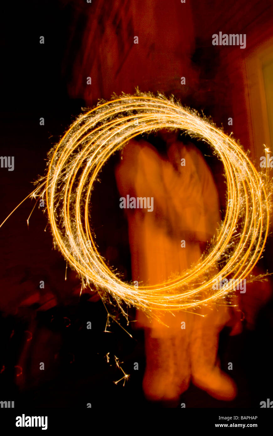 Girl Holding a Sparkler - Stock Image