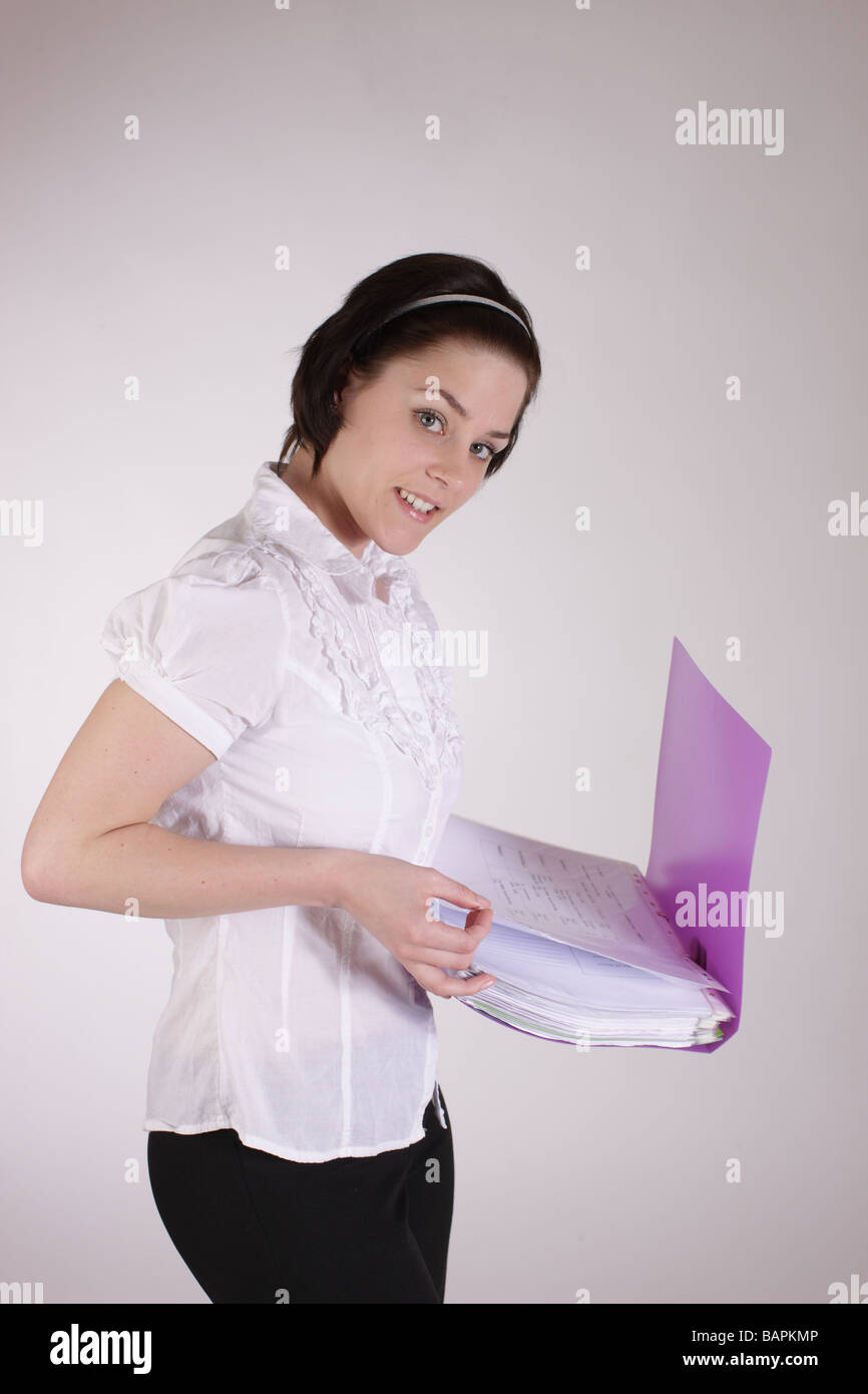 1bab2c64bc04 girl holding a school or office purple folder or loose leaf file - Stock  Image