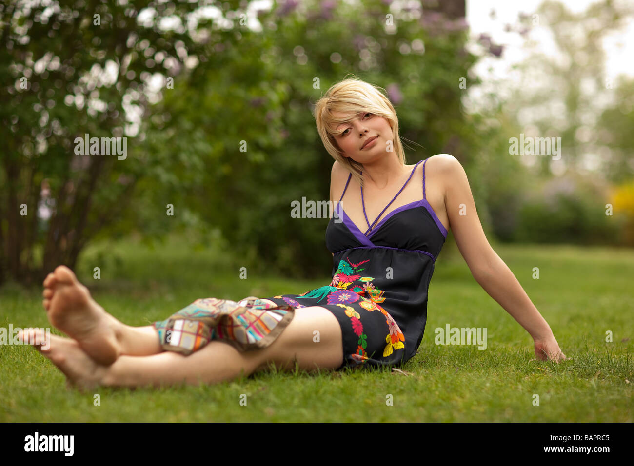Young beautiful woman in the green park Stock Photo