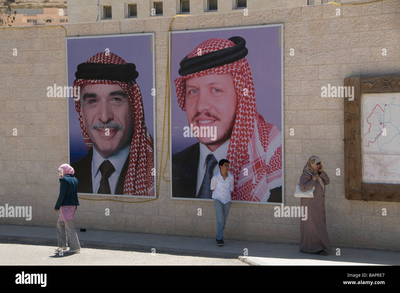 Posters featuring the Hashemites Jordan's Royal kings at the facade of the visitor center in Petra Jordan - Stock Image