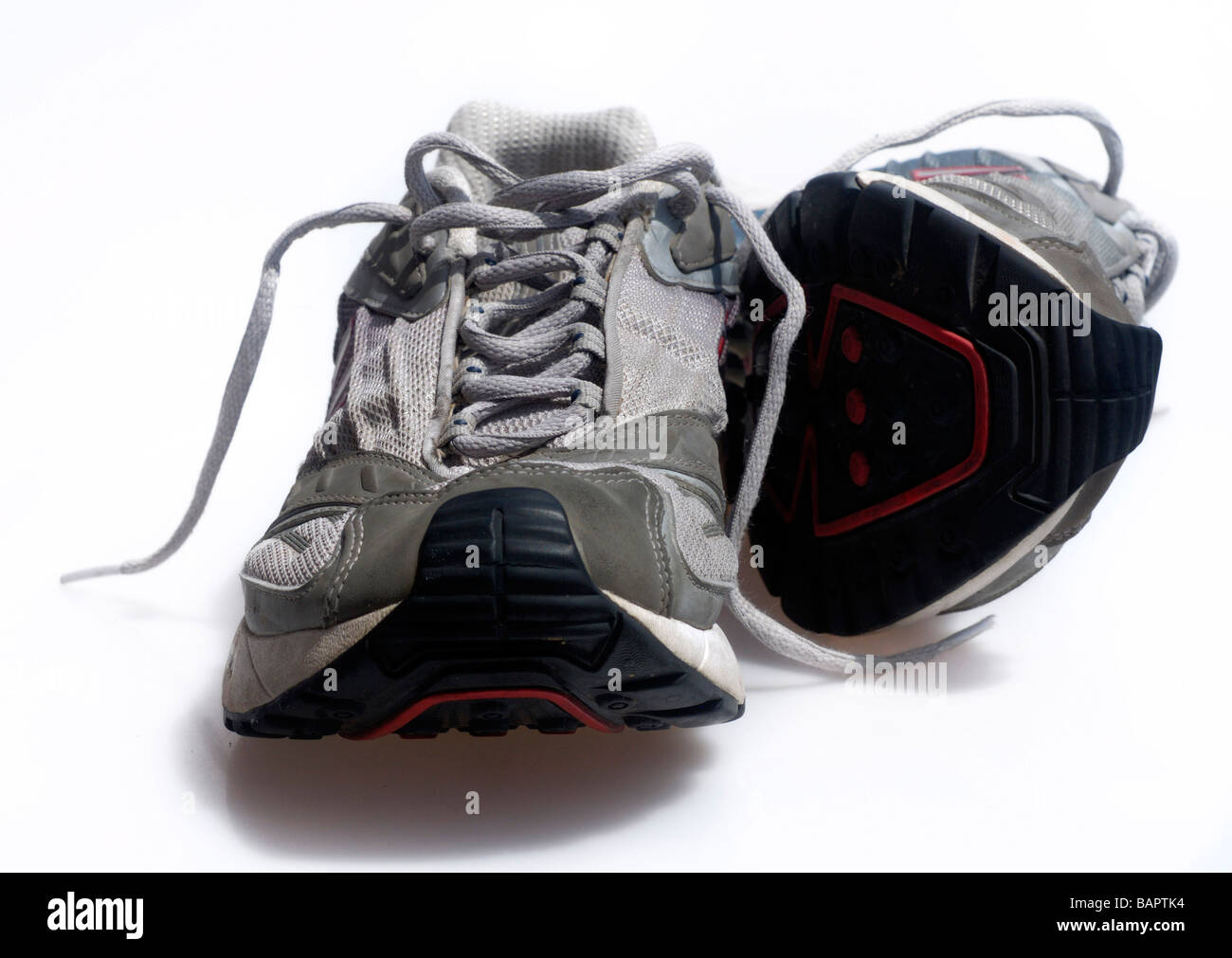 Used worn mens shoes traniners sneakers - Stock Image