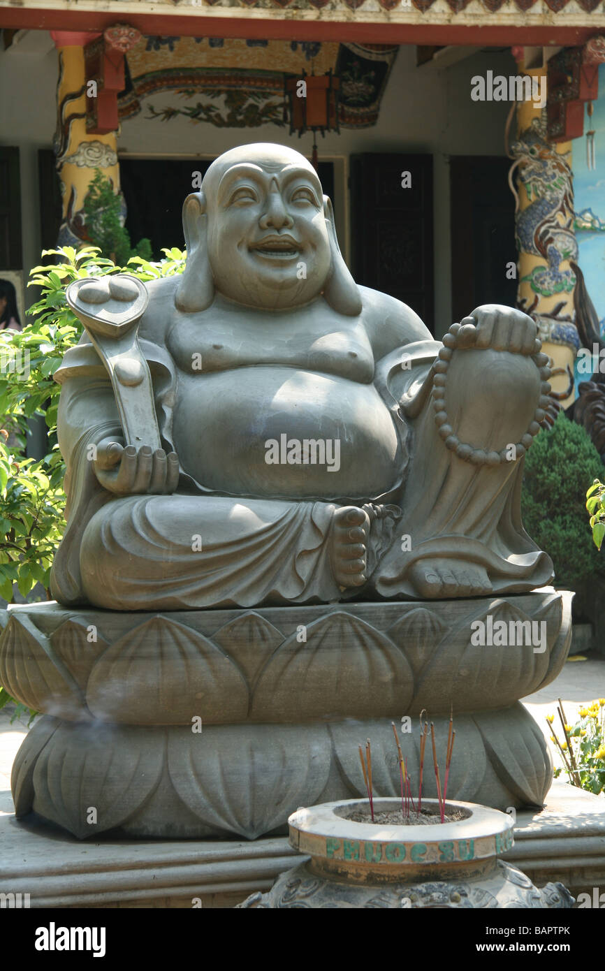 A statue of a happy buddha at the Marble Mountain historic site in Da Nang, Vietnam - Stock Image