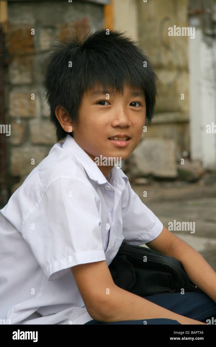 A Vietnamese Schoolboy at the Long Song Temple in Nha Trang, Vietnam - Stock Image