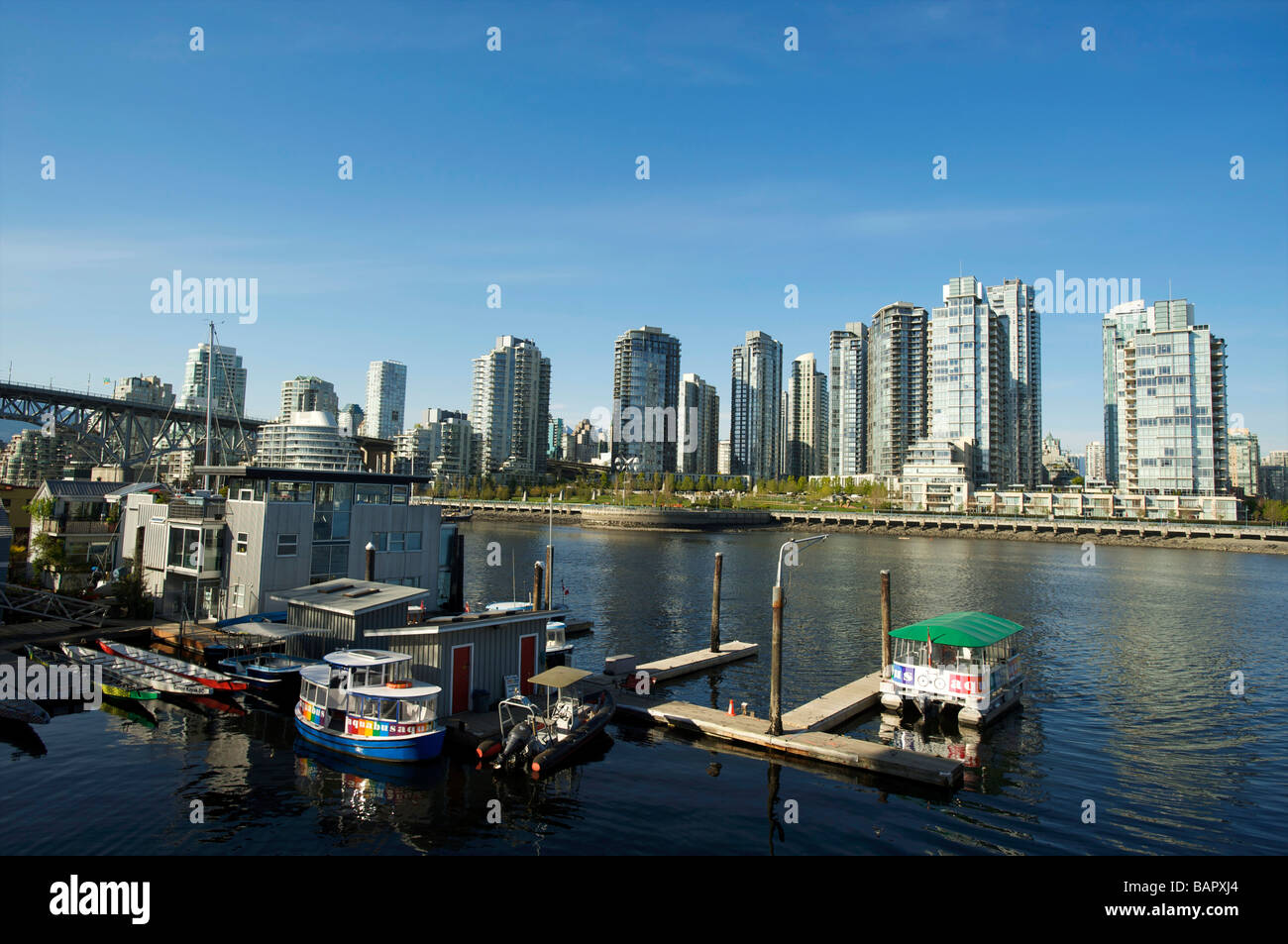 House boats in False Creek with the Condo towers of Yaletown in the background Vancouver BC Canada Stock Photo