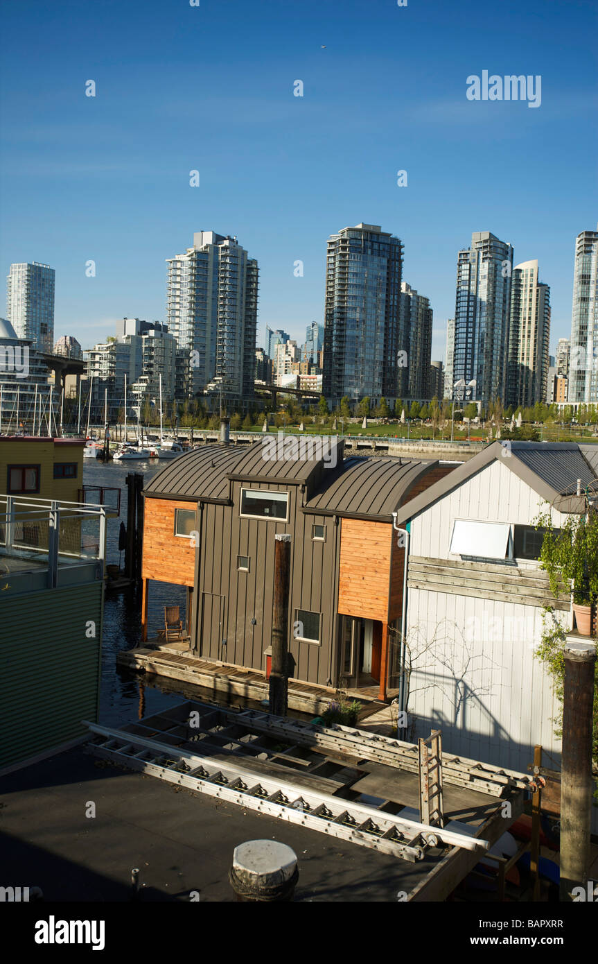 House boats in False Creek with the Condo towers of Yaletown in the background Vancouver BC Canada - Stock Image