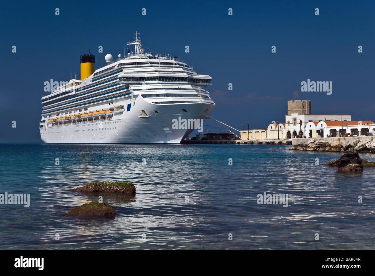 Cruise liner next to Rhodes sea coast, Greece - Stock Image