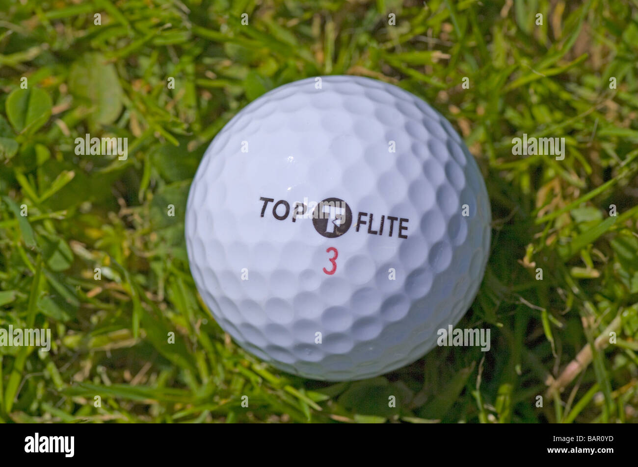 One Top Flite Golf Ball golfball On Grass - Stock Image