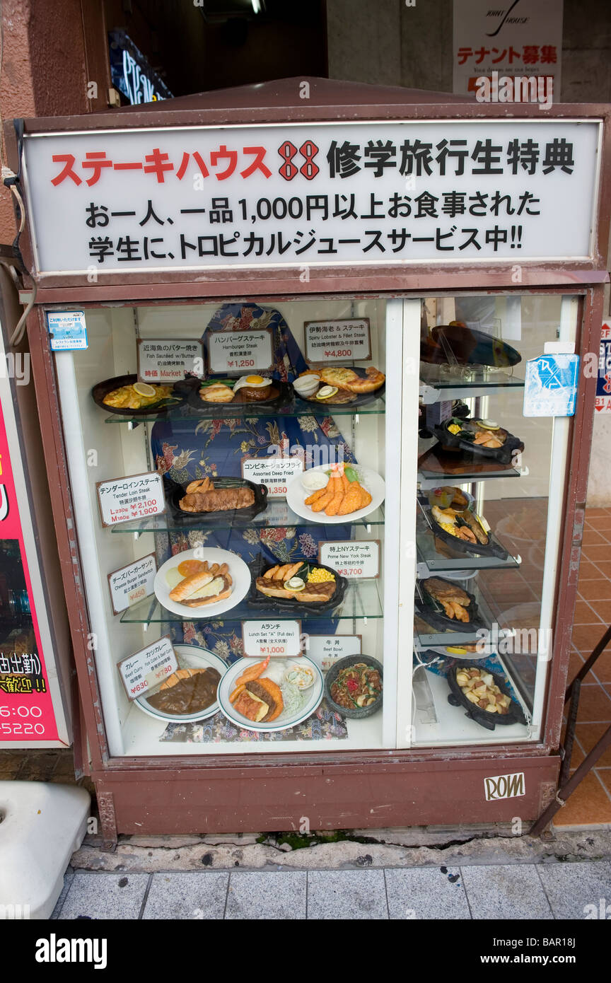 fake japanese food and menu items on display outside a restaurant