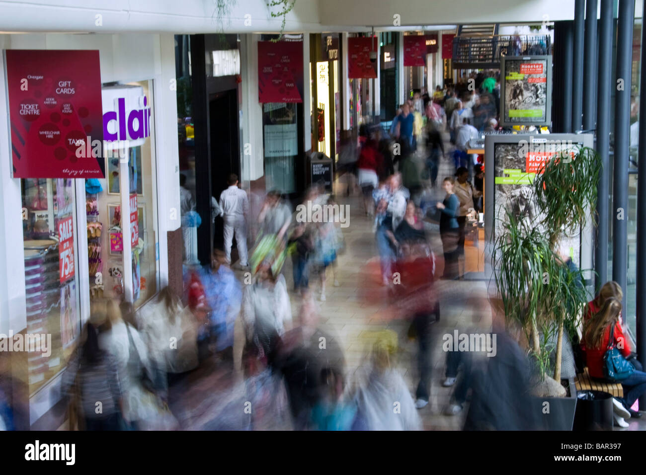 Inside the Overgate shopping mall as shoppers rush around looking for bargains during the credit crunch in Dundee,UK - Stock Image