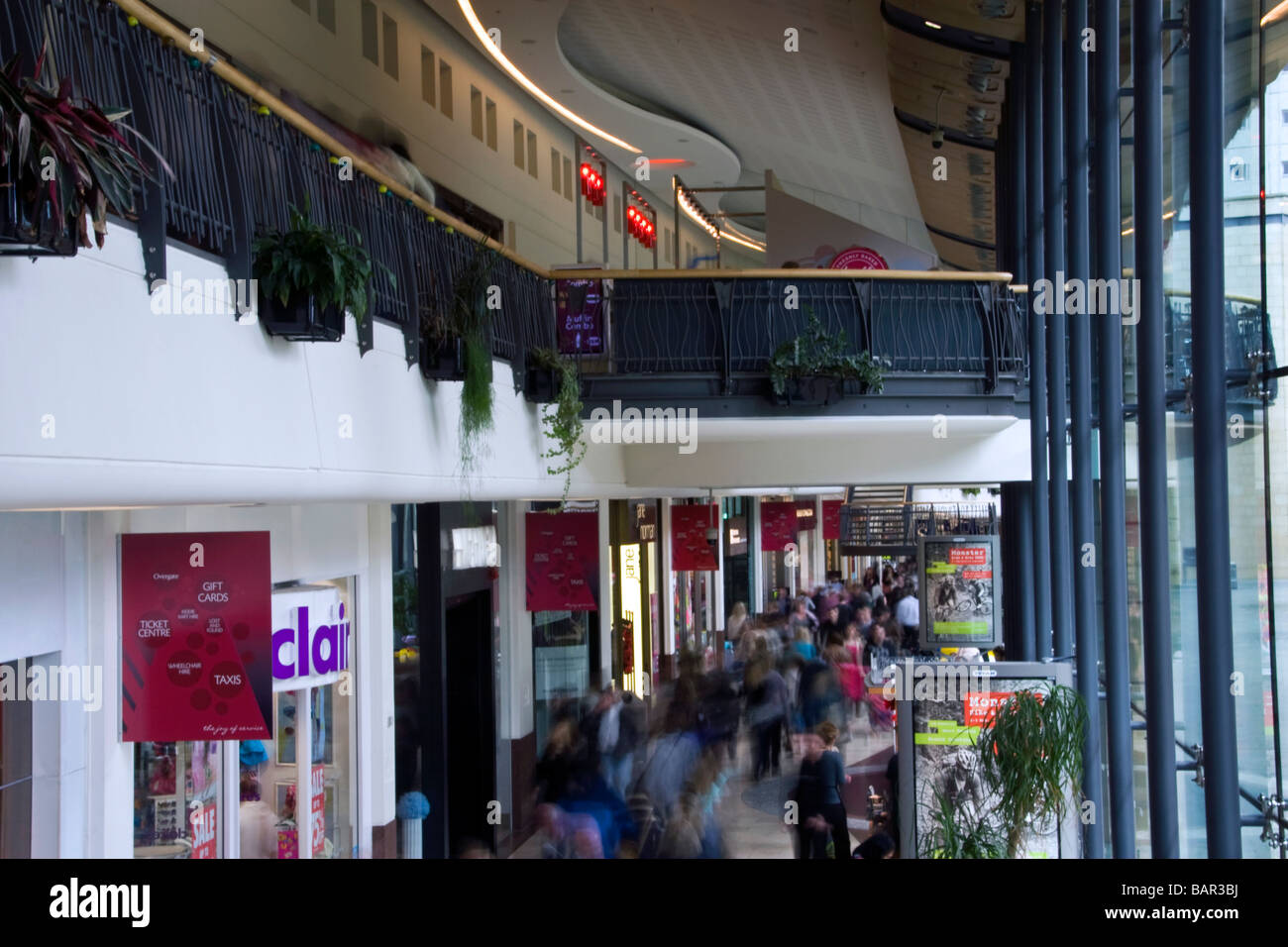 Crowds of shoppers rushing about looking for last minute bargains inside the Overgate shopping mall in Dundee,UK Stock Photo