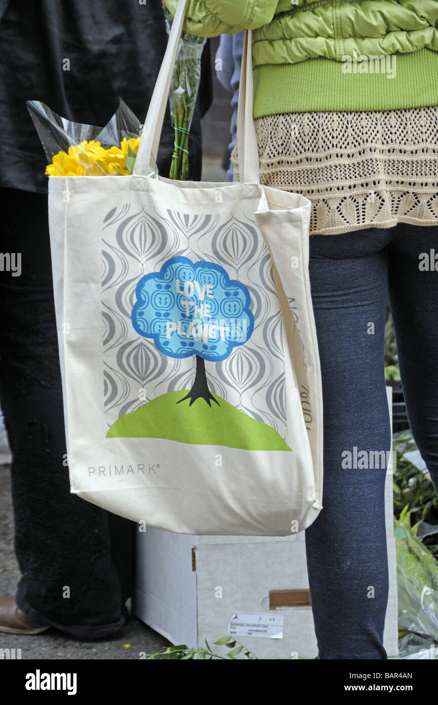 Reusable cotton bag from Primark with love the planet on the side - Stock Image