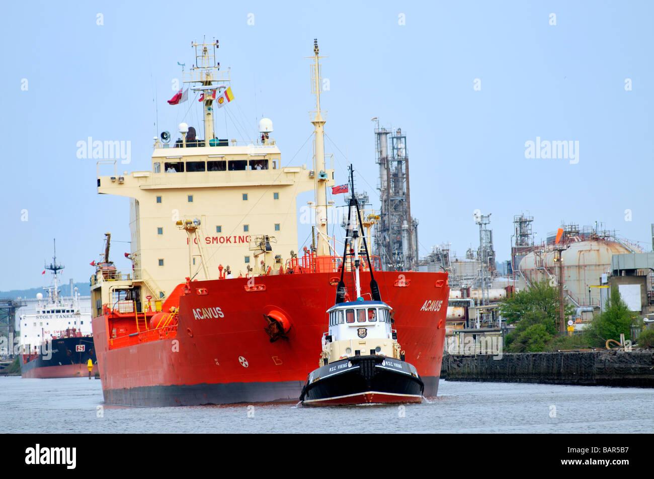 Tugboat MSC Viking guiding the bulk chemical oil products tanker Acavus - Stock Image