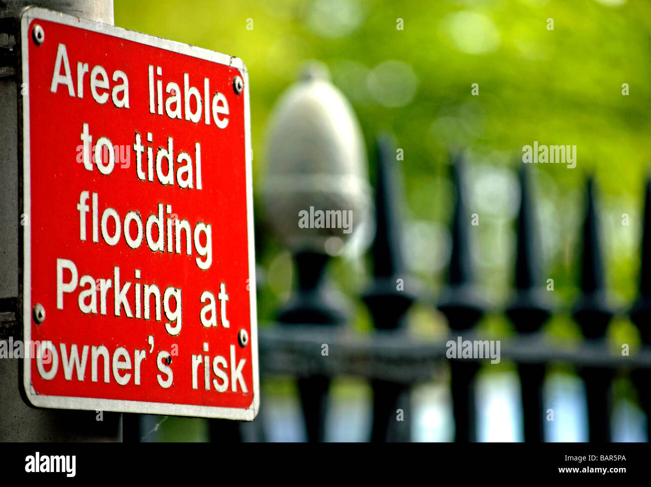 warning sign stating this area is liable to sudden flooding and that parked vehicles are liable to be submerged Stock Photo