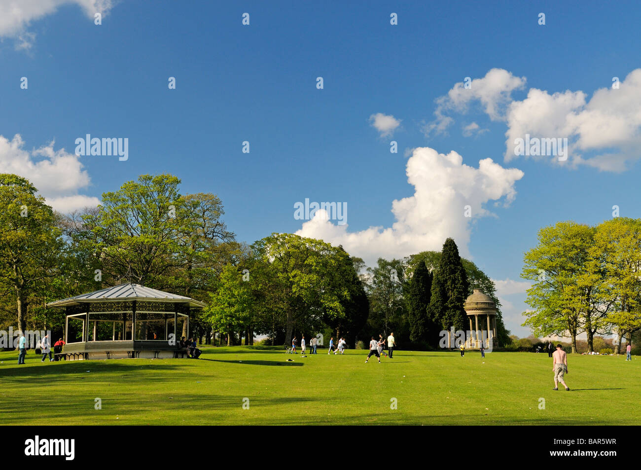 People on lawn of Roundhay Park Leeds West Yorkshire England Stock Photo