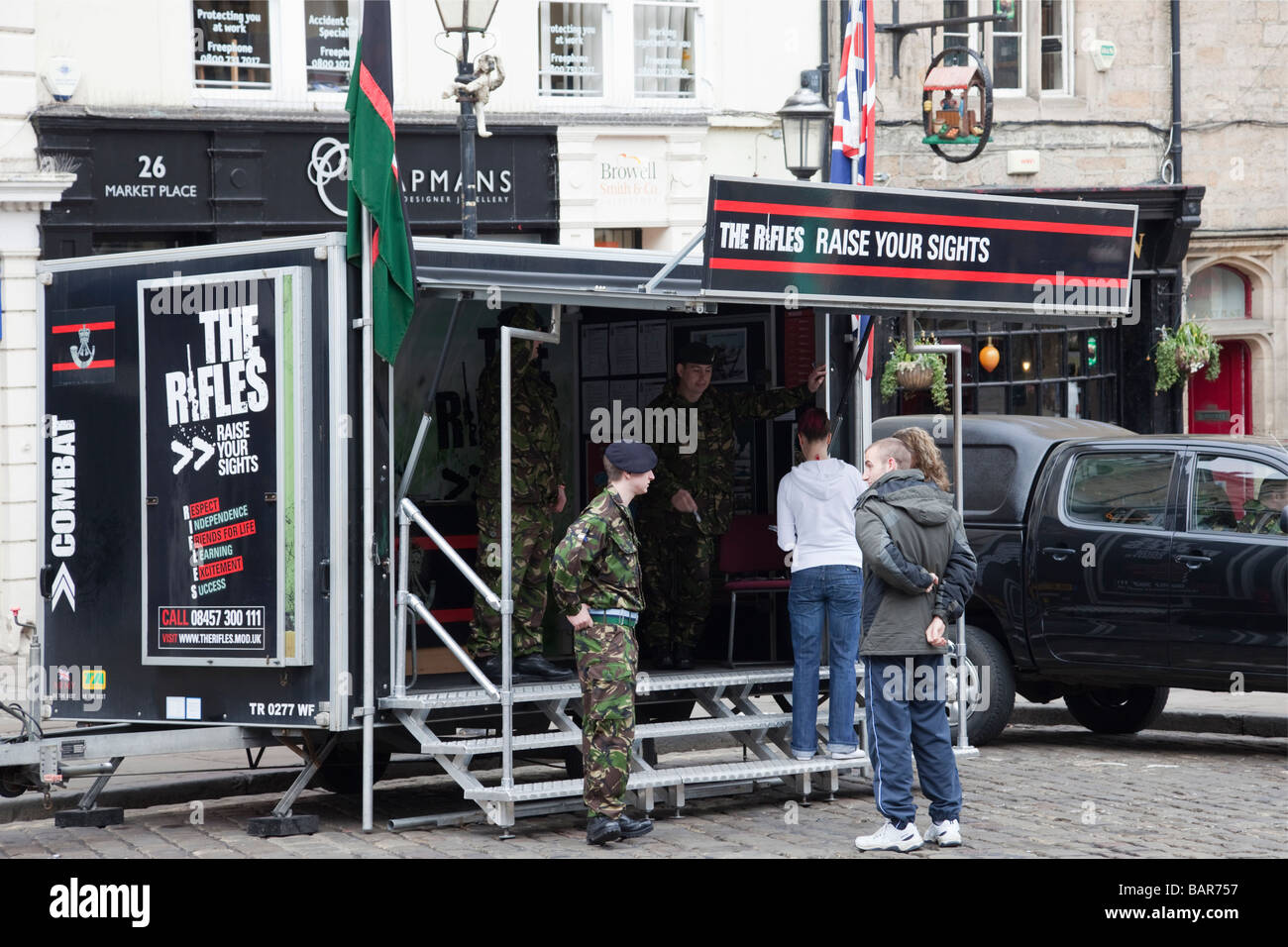 England UK Europe Army recruitment stand for The Rifles regiment with young people enquiring - Stock Image