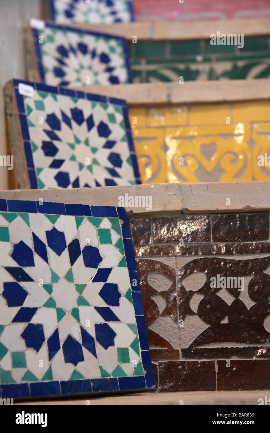 Zellij mosaic tiles displayed for sale on tiled stairs in \'Art Naji ...