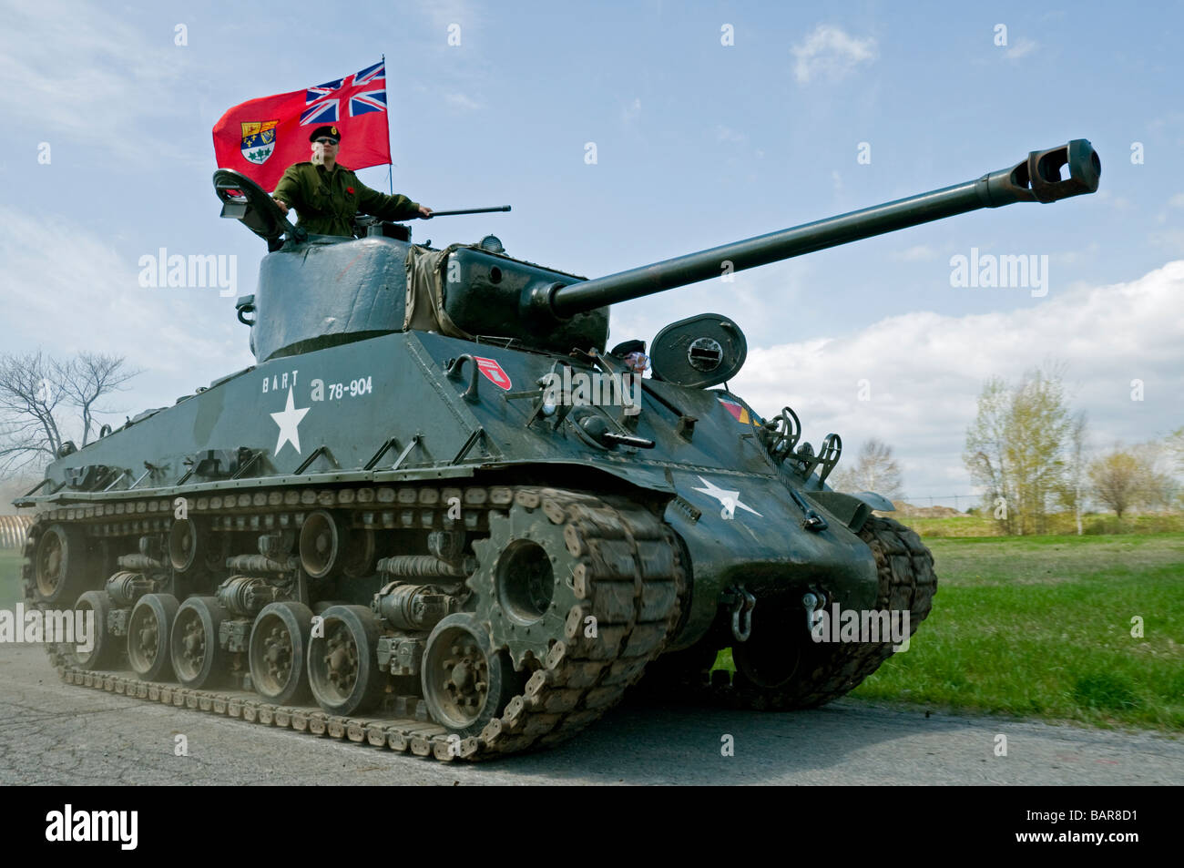 A fully restored IV Sherman tank flying the World War Two Canadian flag. - Stock Image