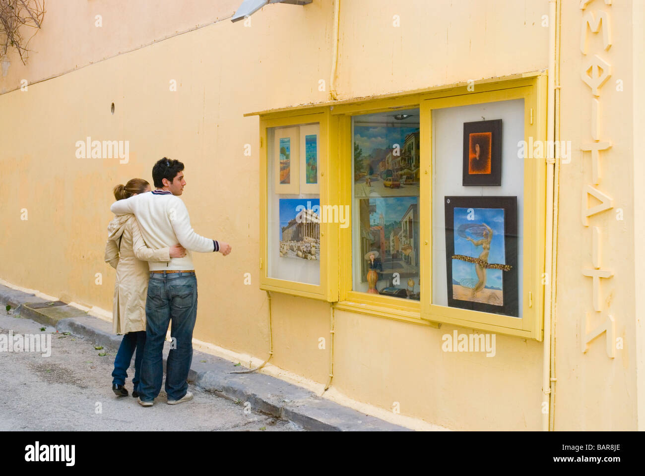 Couple looking at the window of art shop in old town Nafplio Stock ...