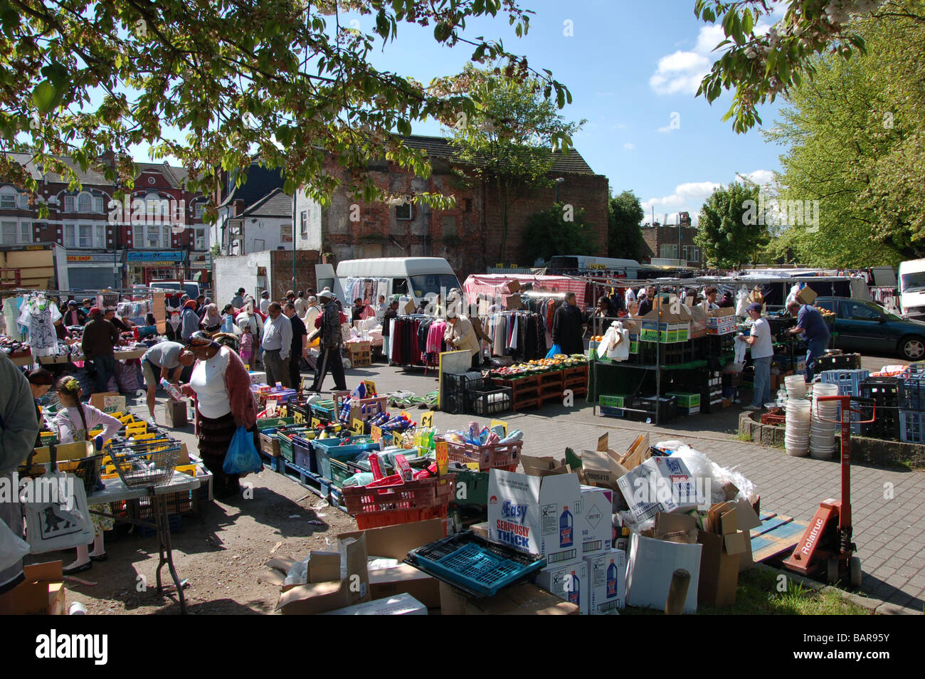 Shoppers at Wednesday's Church road market in Willesden, London, England, Uk - Stock Image