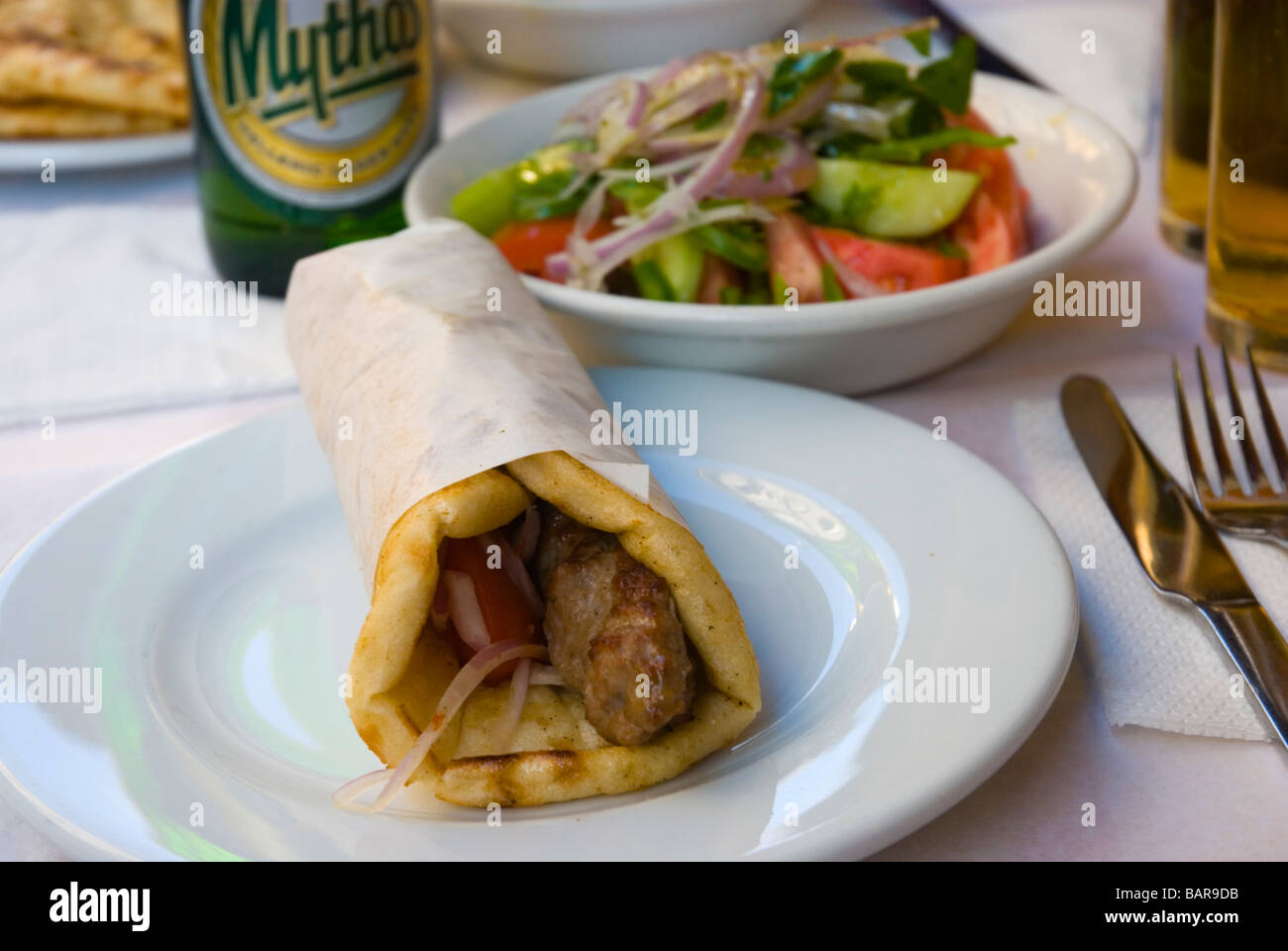 Souvlaki and salad at an outdoor restaurant in Monastiraki district of Athens Greece Europe - Stock Image
