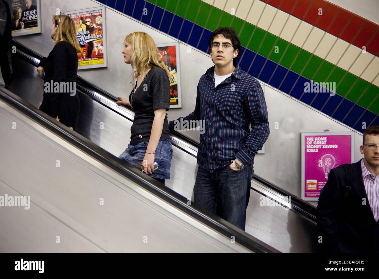 commuters on escalators, London Underground, London, England, UK - Stock Image