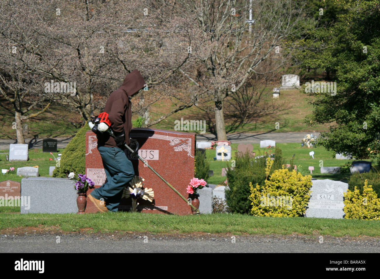groundskeeper working at a cemetery in new york stock photo