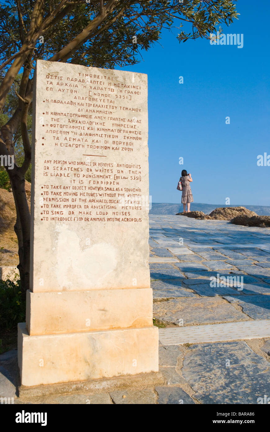 Sign giving visitors rules of conduct at the Acropolis hill Athens Greece Europe - Stock Image