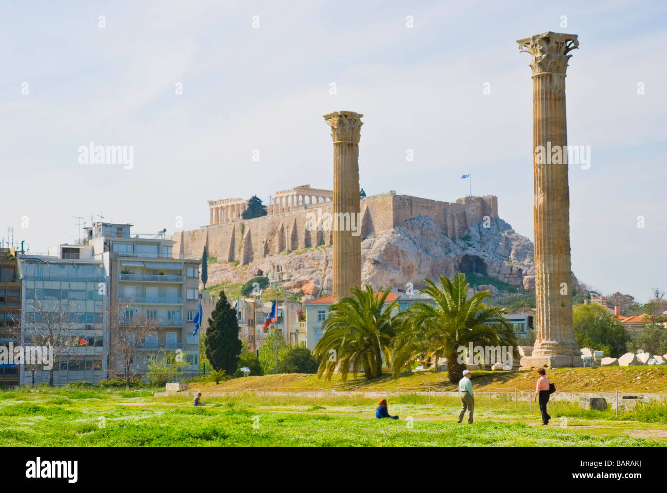 Ruins of Temple of Olympian Zeus site with Acropolis in background in central Athens Greece Europe - Stock Image