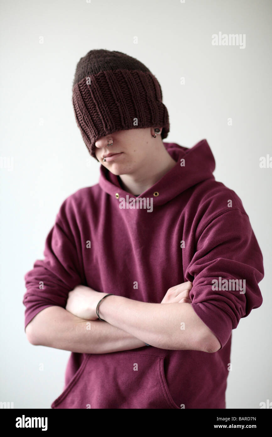 Young man with cap and piercing - Stock Image