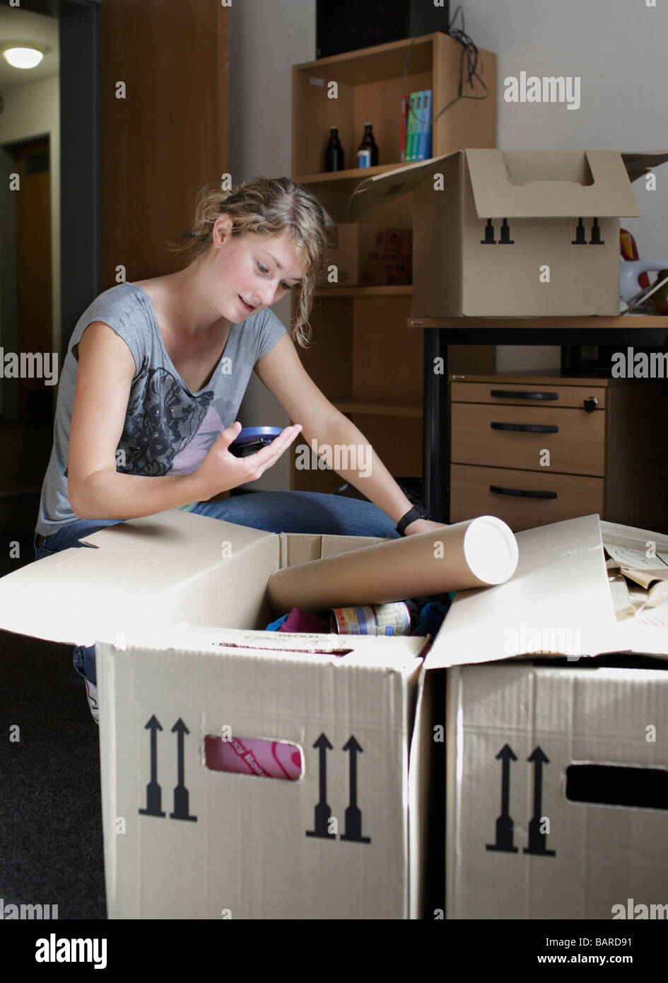 Student move in a new apartment - Stock Image
