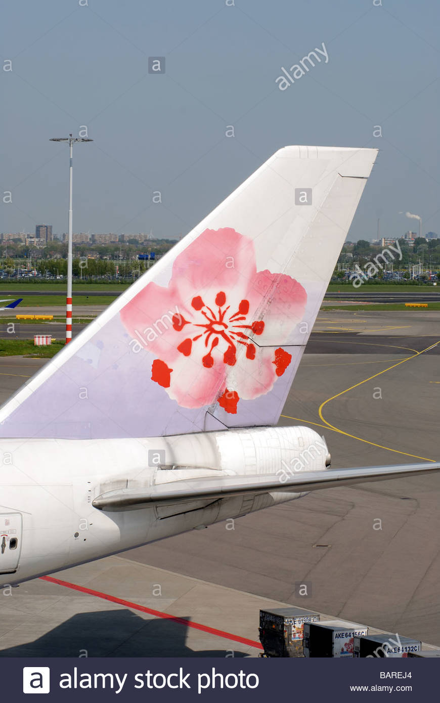 Schiphol Airport The Netherlands China Airlines Boeing 747 'jumbo jet' on the apron. Tailfin. - Stock Image