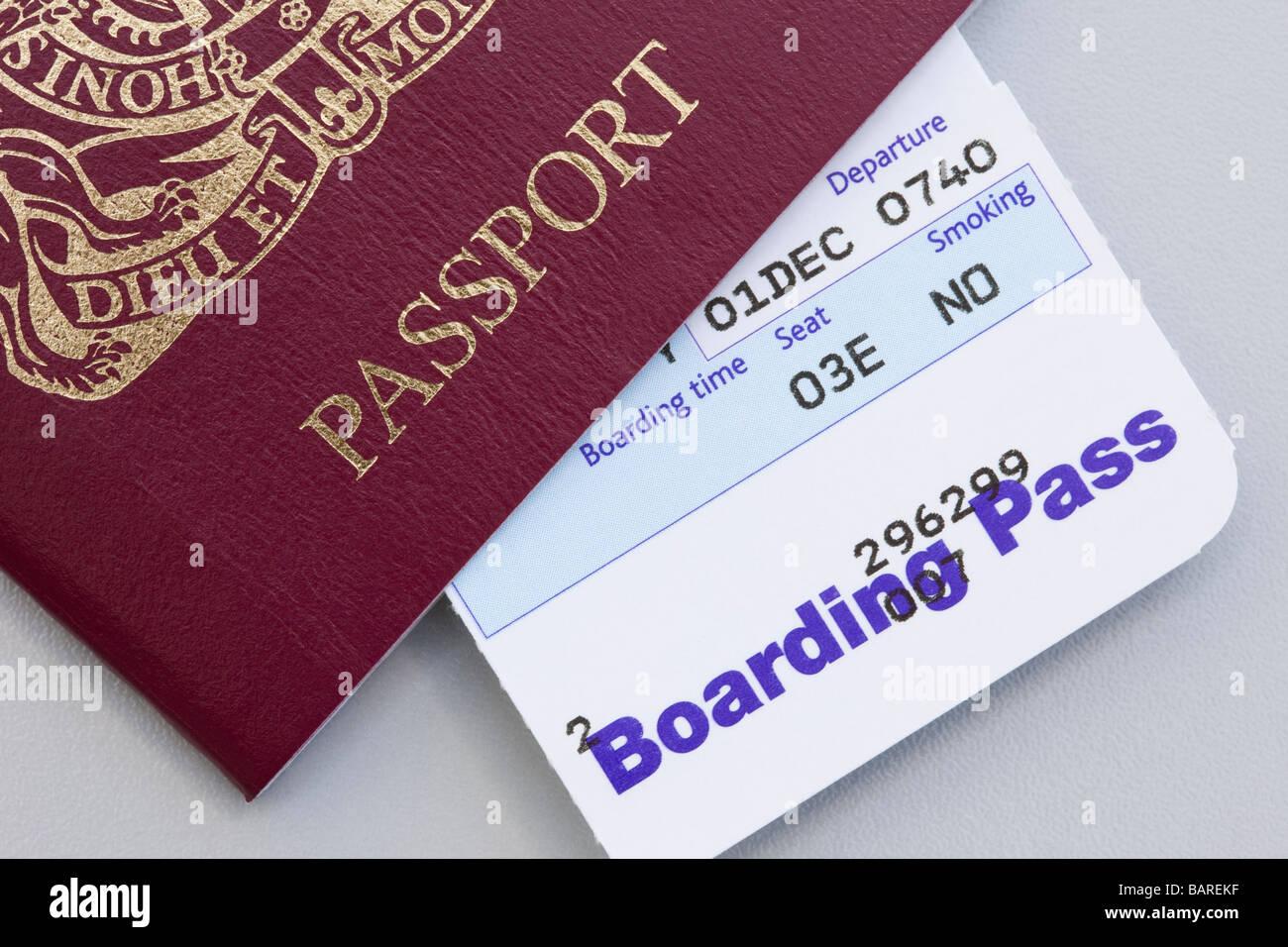 United Kingdom British passport with plane flight Boarding Pass  for travel abroad - Stock Image