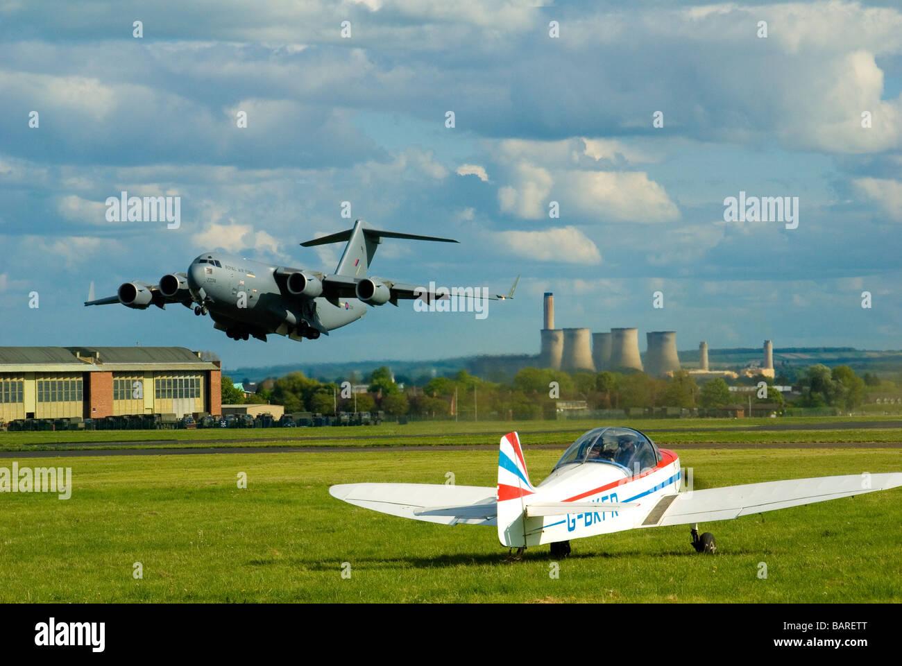 A C-17 Globemaster Military Transport Plane on Take Off - Stock Image