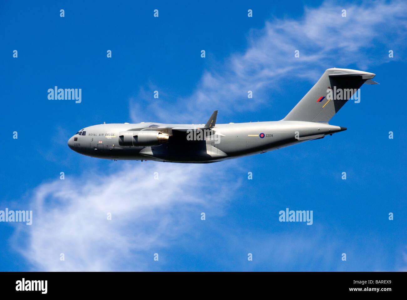 A C-17 Globemaster Military Transport Plane in Flight - Stock Image