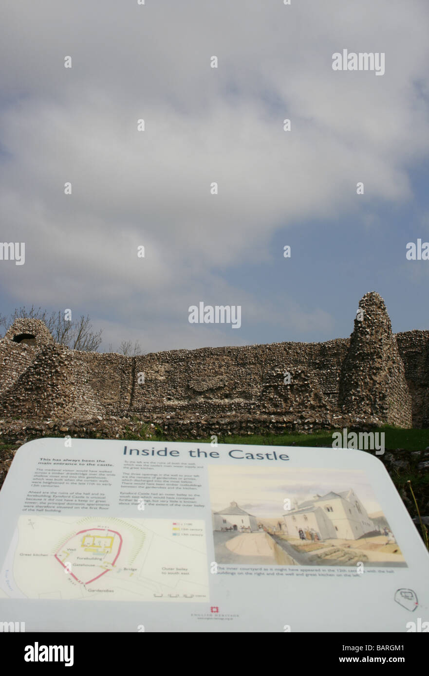 The Norman castle of Eynsford in Kent with a panel explaining the lay out of the castle. In the background is the - Stock Image