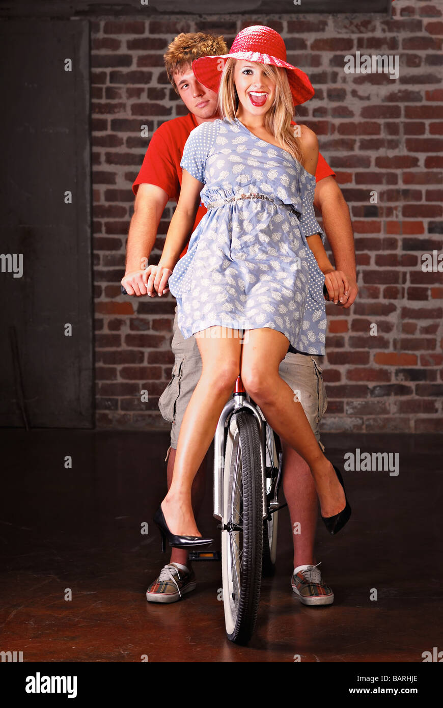 Teenage couple playing around on a bicycle Stock Photo
