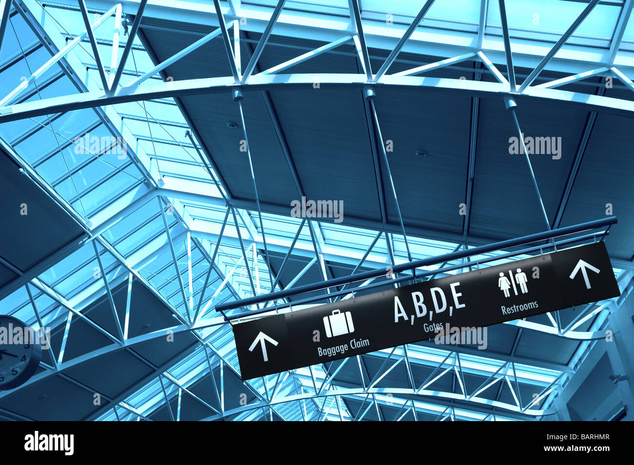 Directional Signs Inside an Airport Terminal Stock Photo