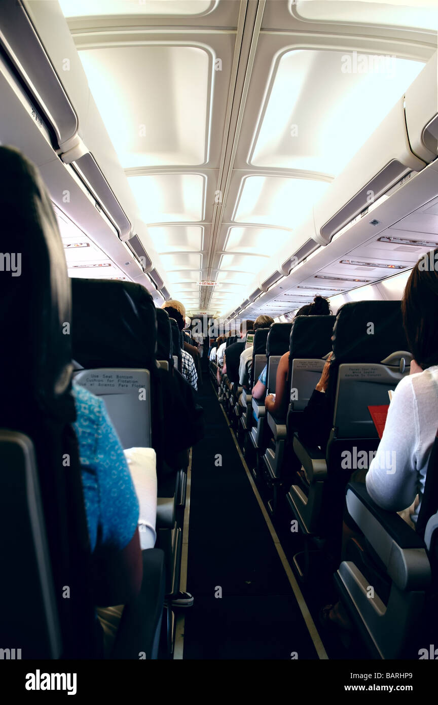 Passengers onboard an airplane Stock Photo