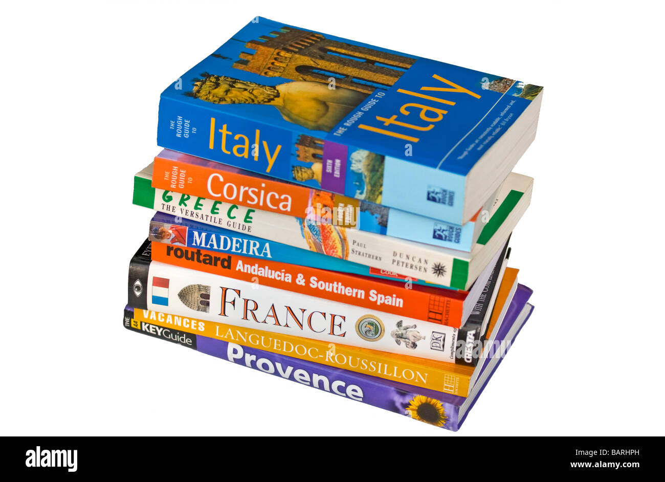 Cut Out of Stacked Travel Guide Books - Stock Image