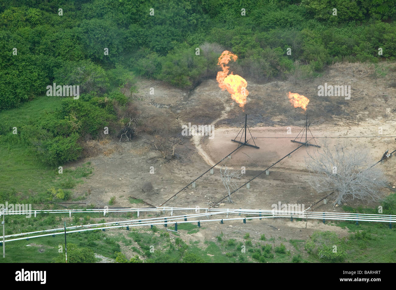 aerial view above PEMEX natural gas tranmission pipelines flare stacks northeastern Mexico - Stock Image