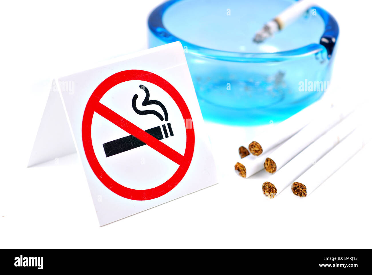 No Smoking sign with cigarettes and ashtray isolated on white background - Stock Image