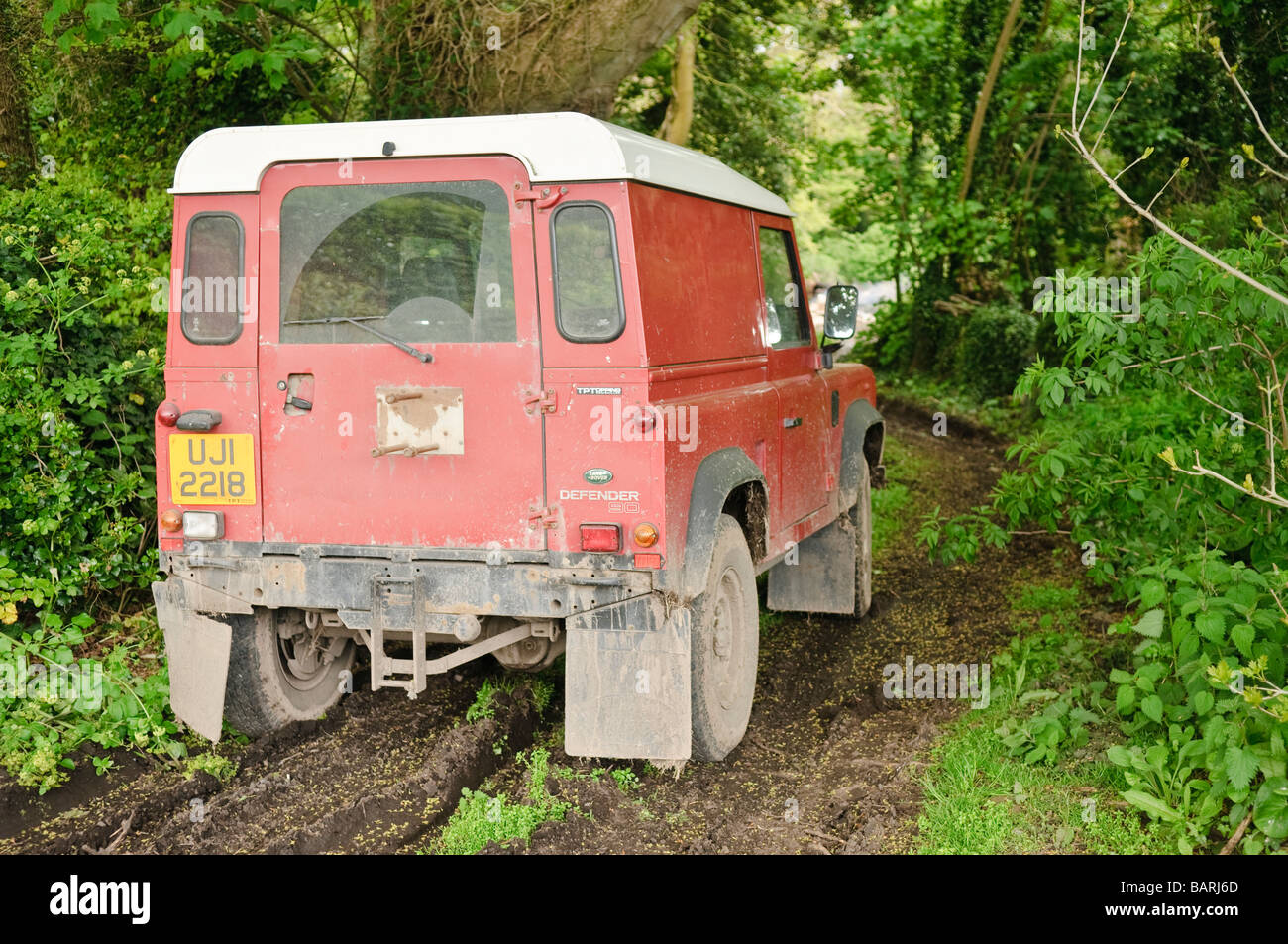 Off-road Landrover on a muddy country lane Stock Photo