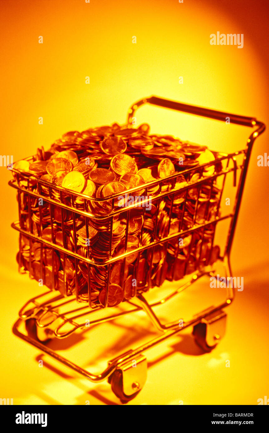 Shopping cart full of pennies - Stock Image
