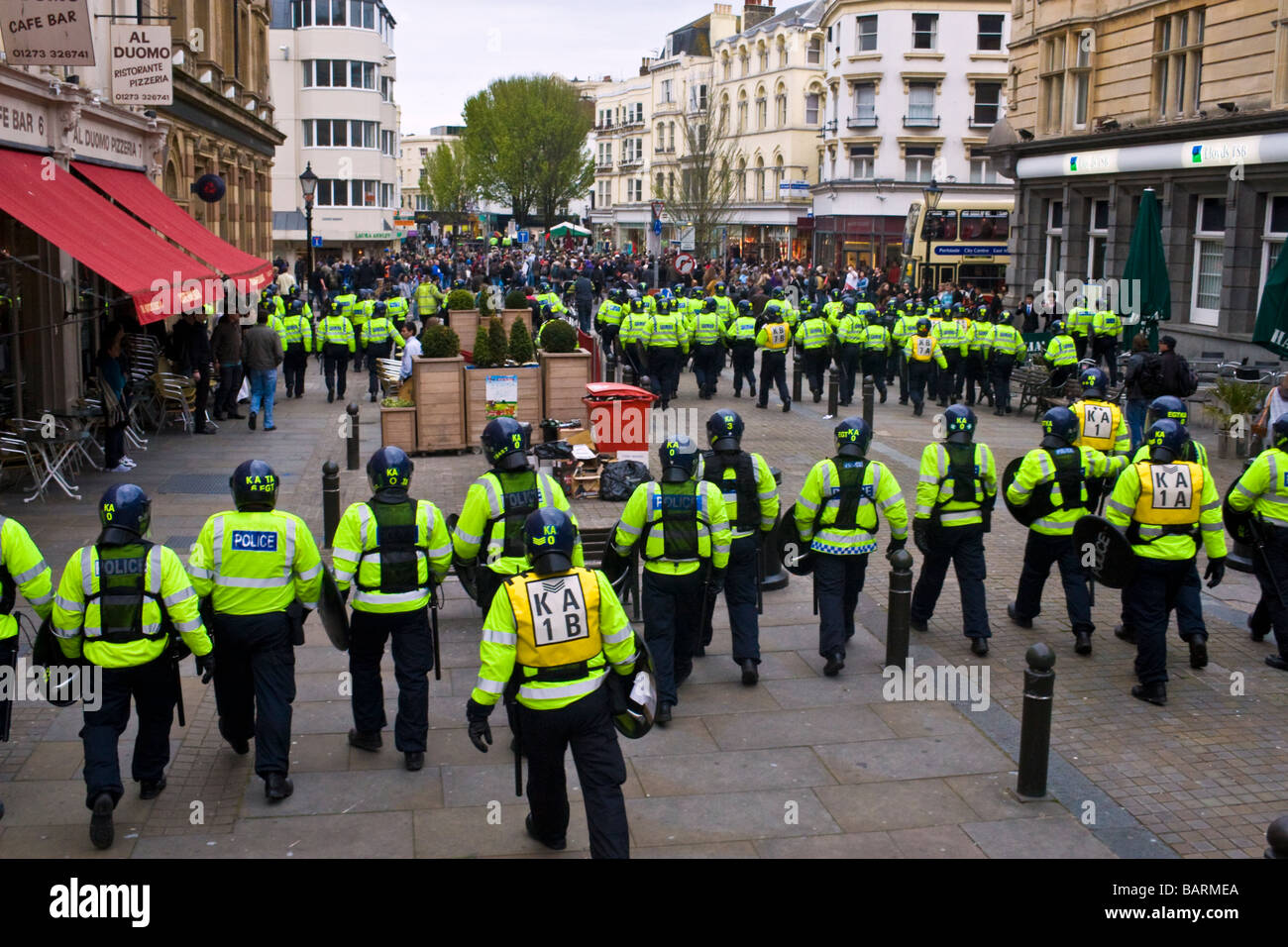 Lines of riot police contain crowds during may day protests in Brighton, Sussex, UK JPH0194 - Stock Image