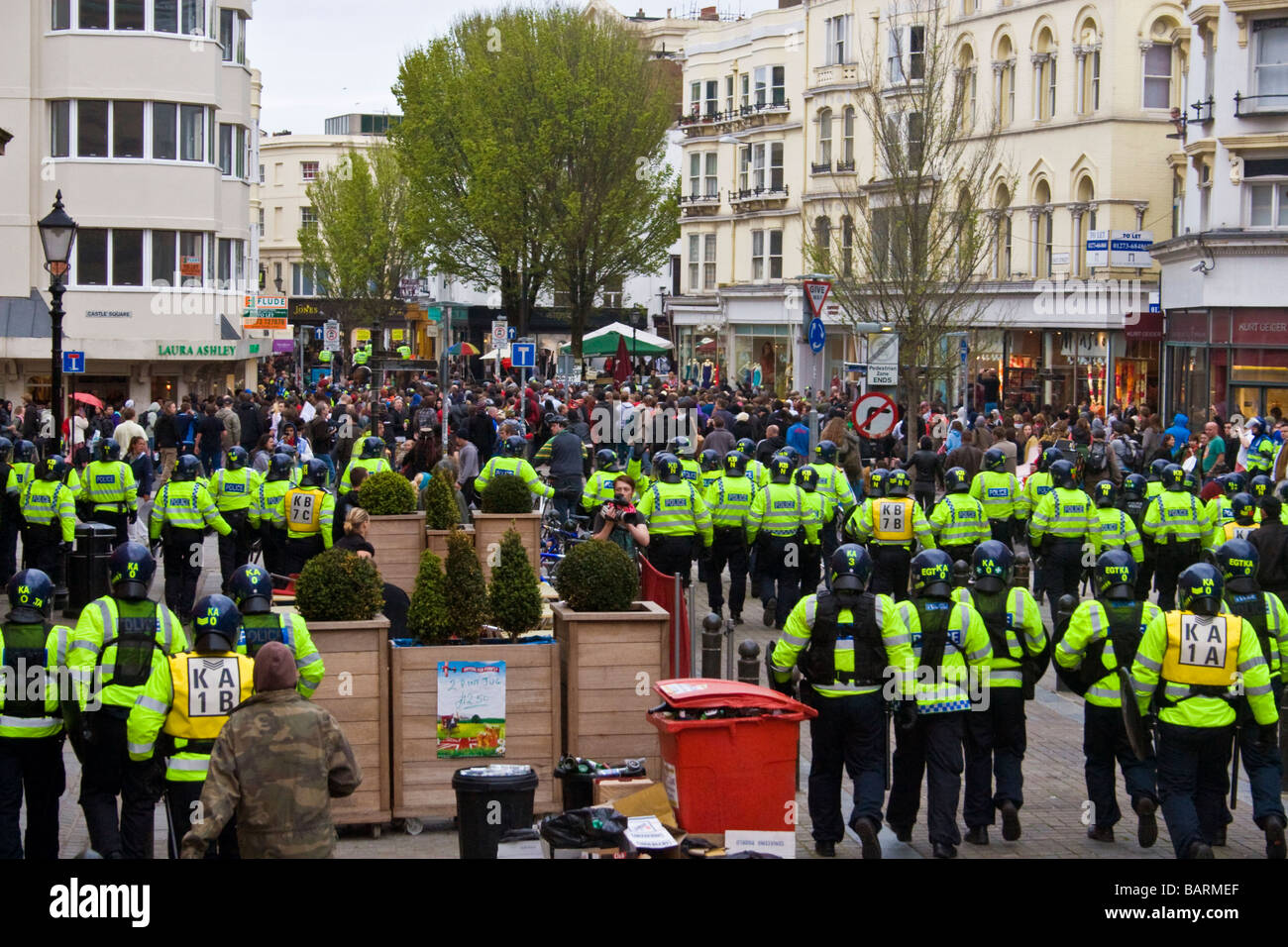 Lines of riot police contain crowds during may day protests in Brighton, Sussex, UK JPH0195 - Stock Image