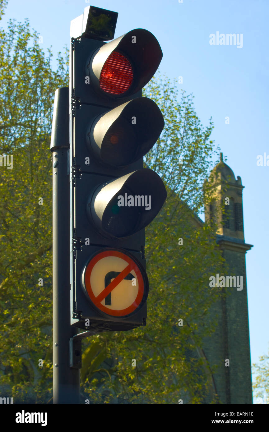 Traffic lights on Highgate Hill with victorian St.Joseph's church in the background. - Stock Image
