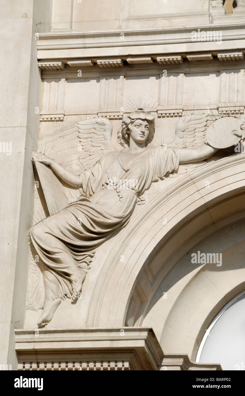 Close up of angel on exterior of Tate Britain gallery Westminster London SW1 - Stock Image