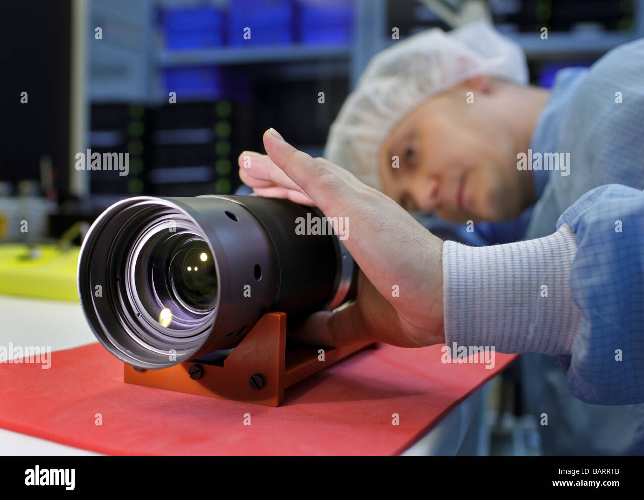 Employee with a camera lens at Carl Zeiss AG Jena Germany - Stock Image